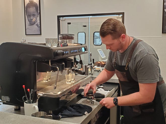 Hope Coffee Co. Manager Charles Myers prepares to make espresso for use in a Dirty Chai Latte and a Mocha Frappe.