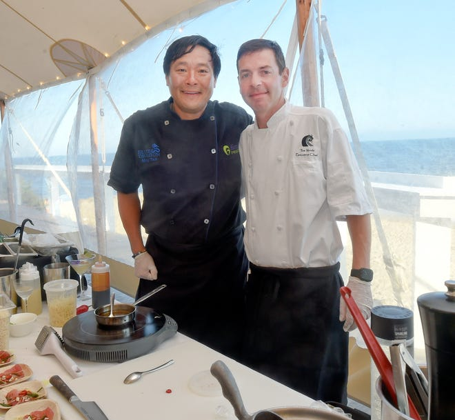 Chefs Ming Tsai (left) and Tom Woods at The Ocean House restaurant in Dennis Port, with Nantucket Sound just steps away. Tsai brought one of his favorite nonprofits, Family Reach, to Cape Cod, where he cooked with Woods, his former apprentice.