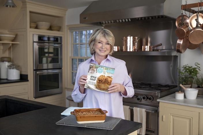 martha stewart in kitchen holding frozen apple crips